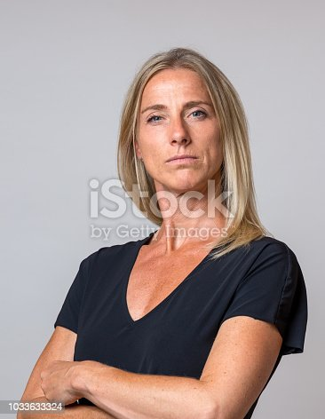istock Imperious haughty woman with folded arms 1033633324
