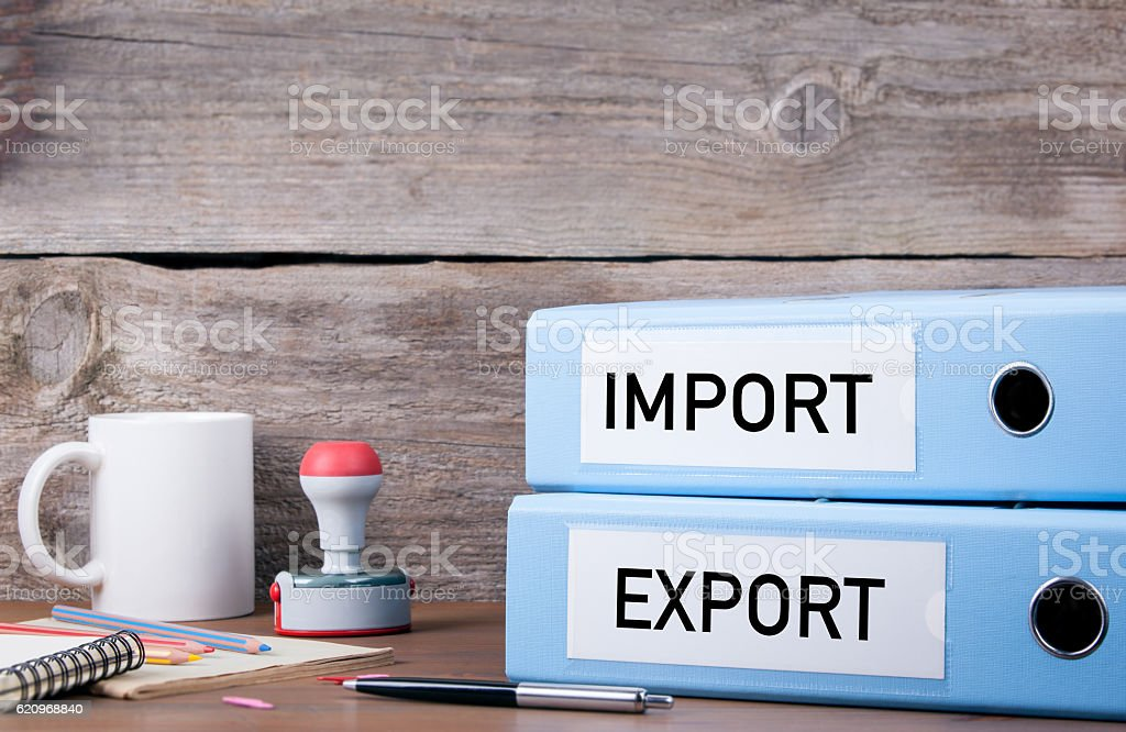 Import and Export. Two binders on desk stock photo