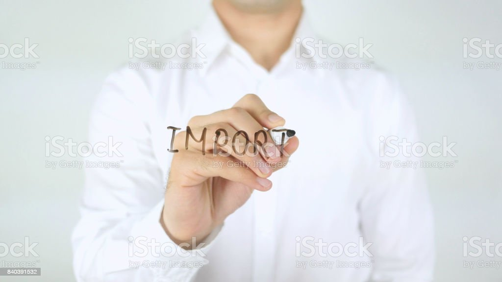 Import, Man Writing on Glass stock photo