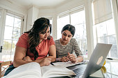 Mom and daughter studying together.