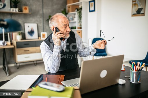 913346608 istock photo Important business phone call in the office 1200707476