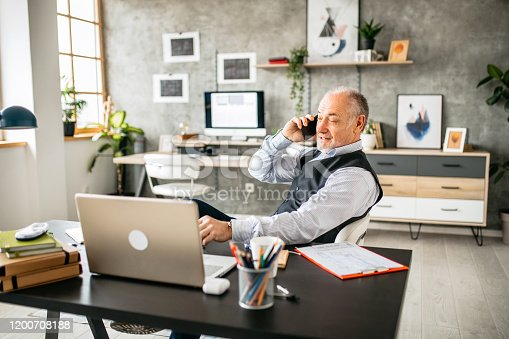 913346608 istock photo Important business phone call in the office 1200708188