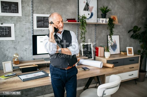 913346608 istock photo Important business phone call in the office 1200708285