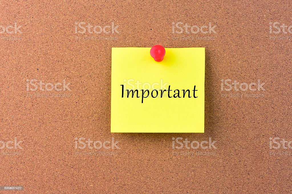 Important Message on a Noticeboard. stock photo