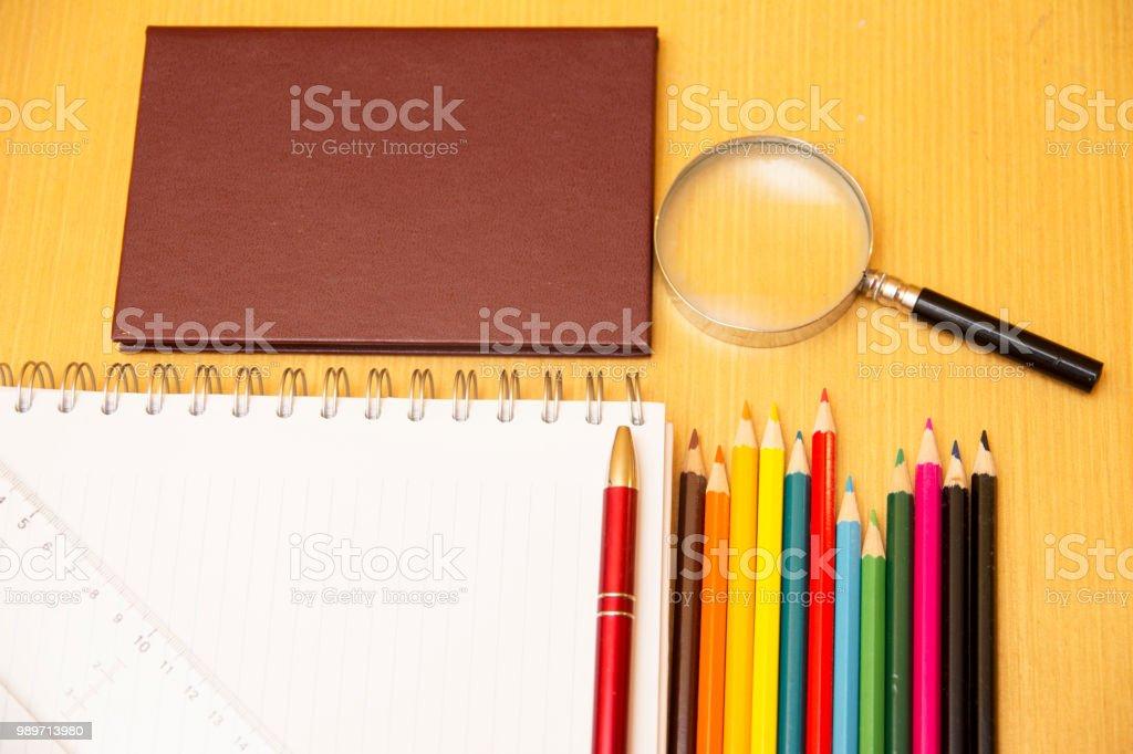 Important School supplies on wooden desk stock photo