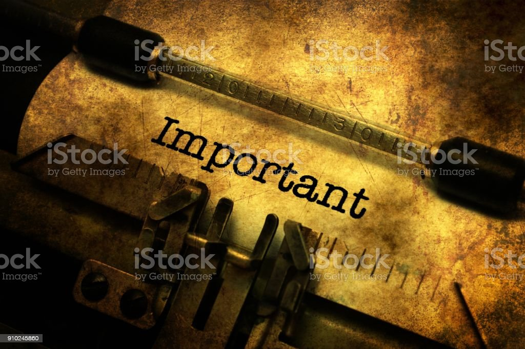 Important text on typewriter grunge concept stock photo