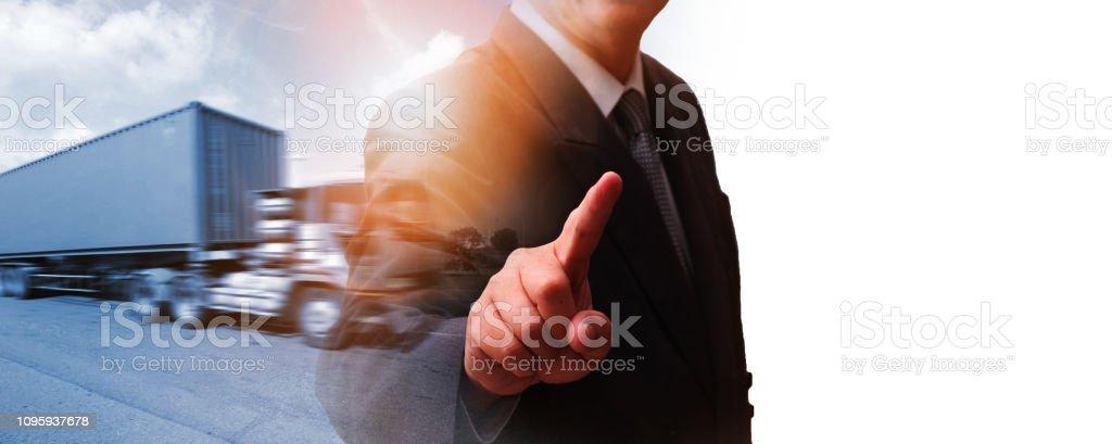 Generic big trucks speeding on the highway with businessman working...