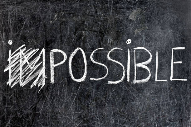 impossible becomes possible handwritten with white chalk dirty blackboard - possible stock photos and pictures