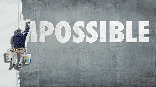 impossible becoming possible - conquering adversity stock photos and pictures