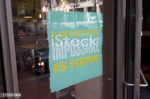 Portland, Oregon, USA - Sep 6, 2019: A QDOBA Mexican Eats restaurant in downtown Portland advertises the availability of Impossible brand plant-based protein.