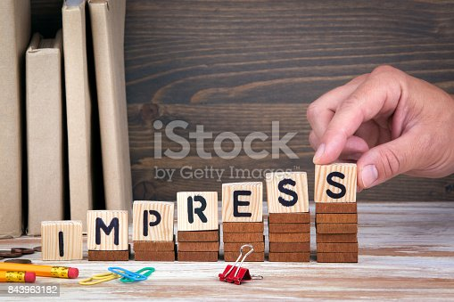 istock Impress concept. Wooden letters on the office desk, informative and communication background 843963182