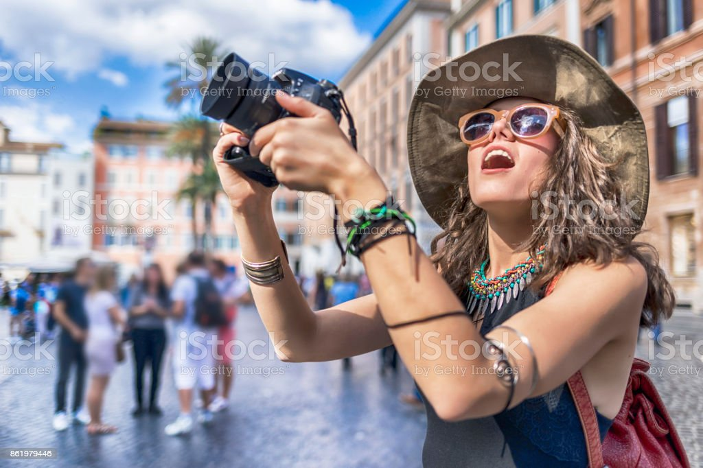 Impressed tourist taking pictures on Piazza di Spagna stock photo