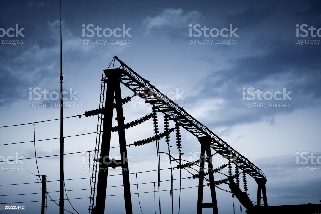 Impression network at transformer station in sunrise, high voltage up...