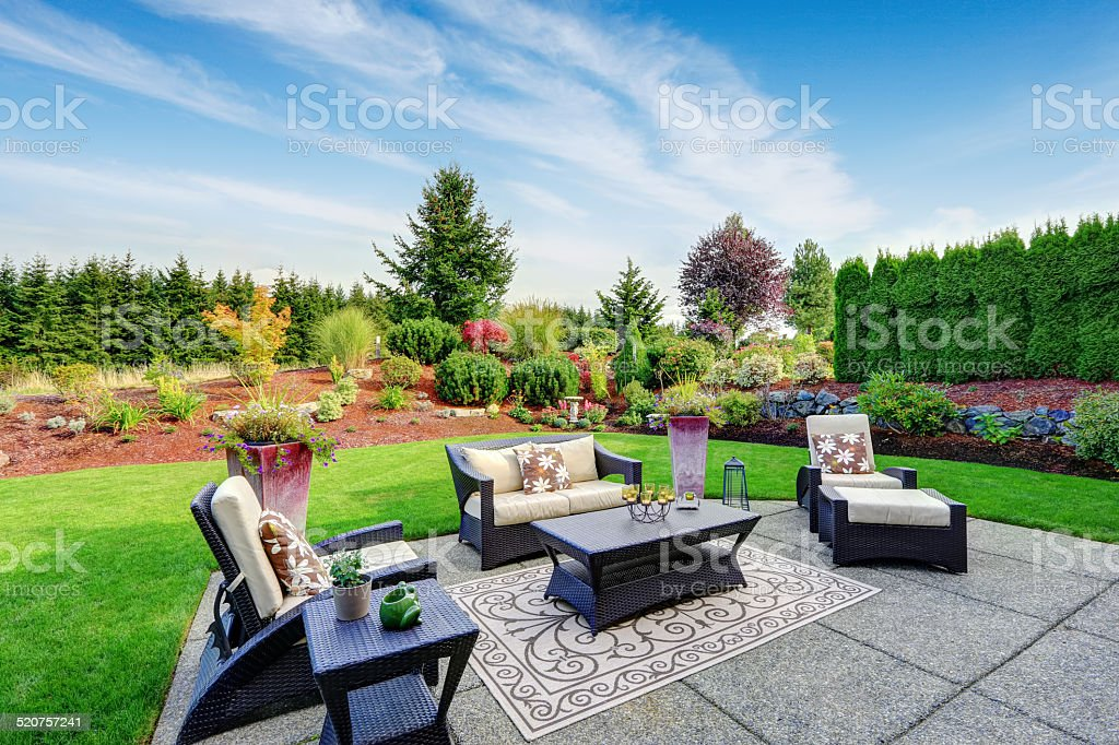 Impressive backyard landscape design with patio area stock photo