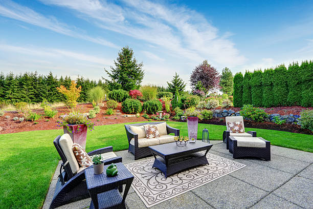 impressive backyard landscape design with patio area - backyard stock pictures, royalty-free photos & images