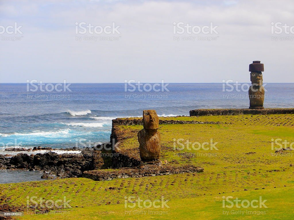 Impressive Easter Island - Rapa Nui ancient civilization -  Moai statues in Idyllic countryside and pacific ocean waves at coastline shore, dramatic landscape panorama – Chile stock photo