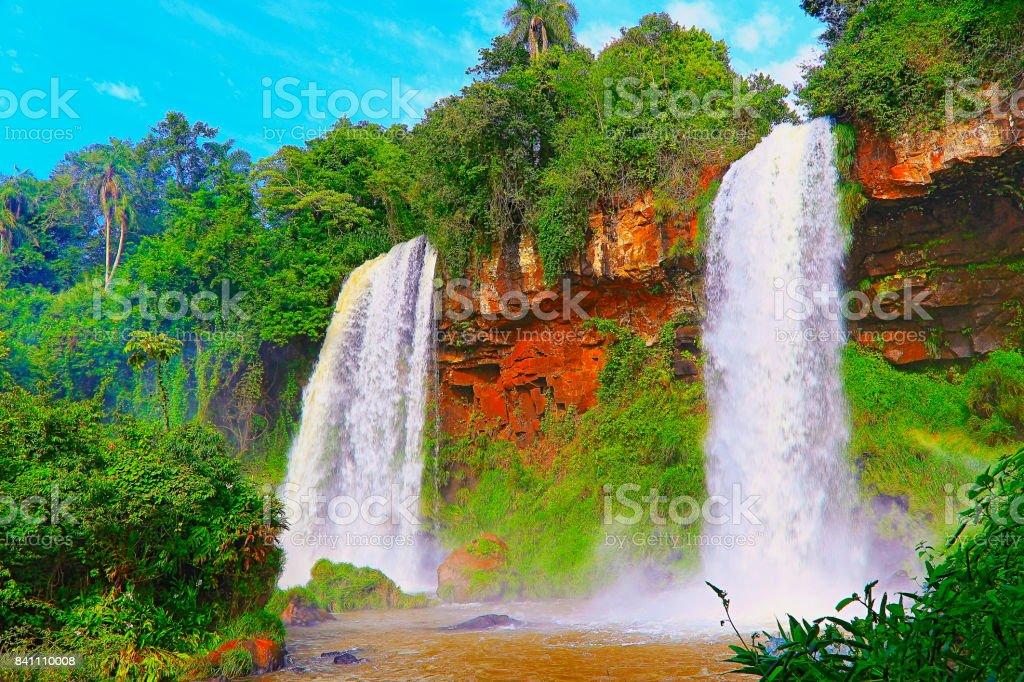 Impressive Iguacu falls landscape with rainforest on the Argentina side, dramatic beauty in nature landscape - Idyllic Devil's Throat - international border of Brazilian Foz do Iguacu, Parana, Puerto Iguazu, Misiones and Paraguay - South America