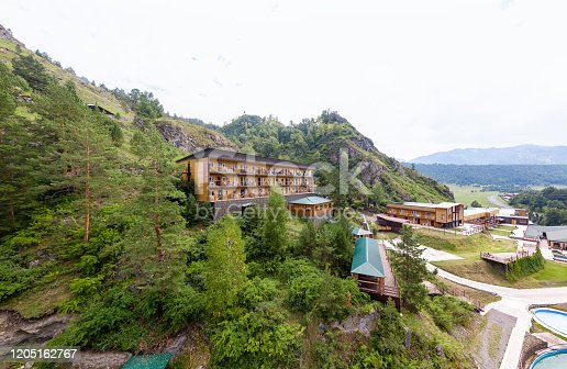 istock Impressive view of Altai Chemal village. Picturesque and gorgeous scene. Popular tourist attraction. Location place Altay mountains, Russia valley. Beauty world with green trees and nature environment 1205162767