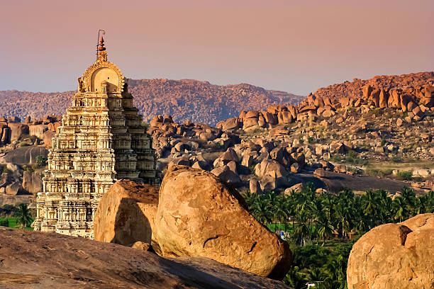 Impressive Virupaksha temple Impressive Virupaksha temple in Hampi, Karmataka, India. tuff stock pictures, royalty-free photos & images
