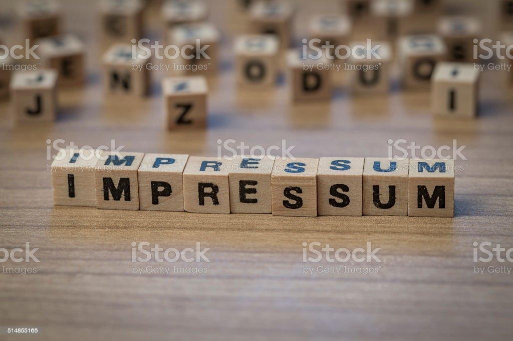 Impressum schriftliche in hölzerne Würfel - Lizenzfrei Impressum Stock-Foto