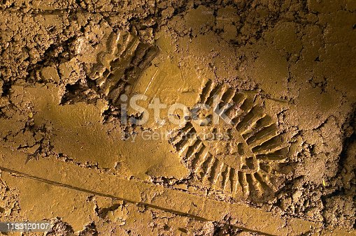 Shot of a single imprint of a shoe or boot on mud