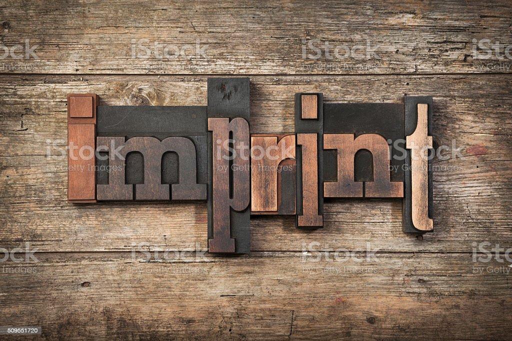 imprint, written with letterpress blocks stock photo