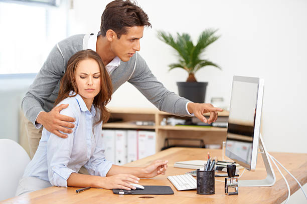 Improper conduct for the office Shot of a male coworker acting inappropriately in the workplace harassment stock pictures, royalty-free photos & images