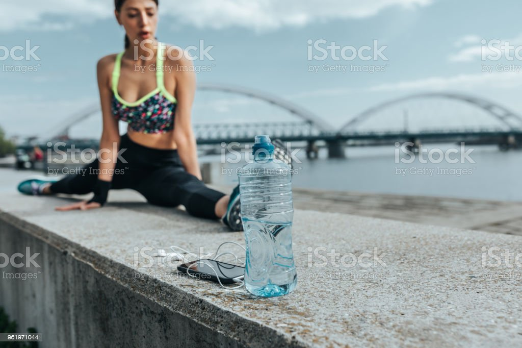 Shot of a fit young woman doing splits outdoors