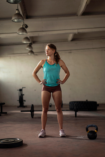Semi portrait photo of a young woman after finishing her workout