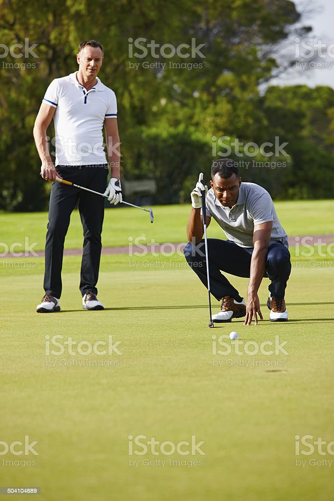Improving their handicap one ball at a time stock photo