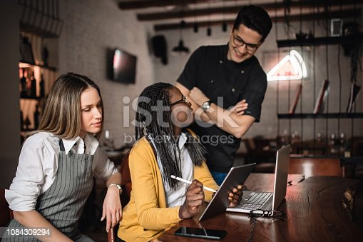 Restaurant manager making new suggestions to the employees