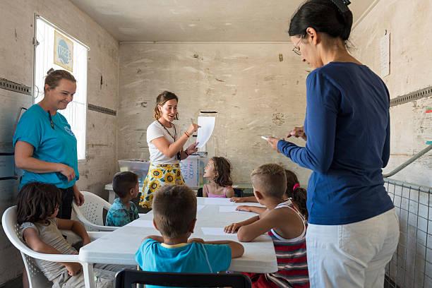 Improvised school for refugee children in Greece stock photo