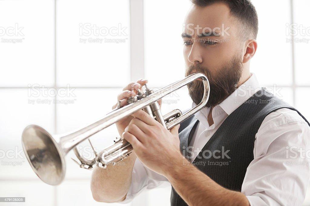 Improvising with his trumpet. stock photo