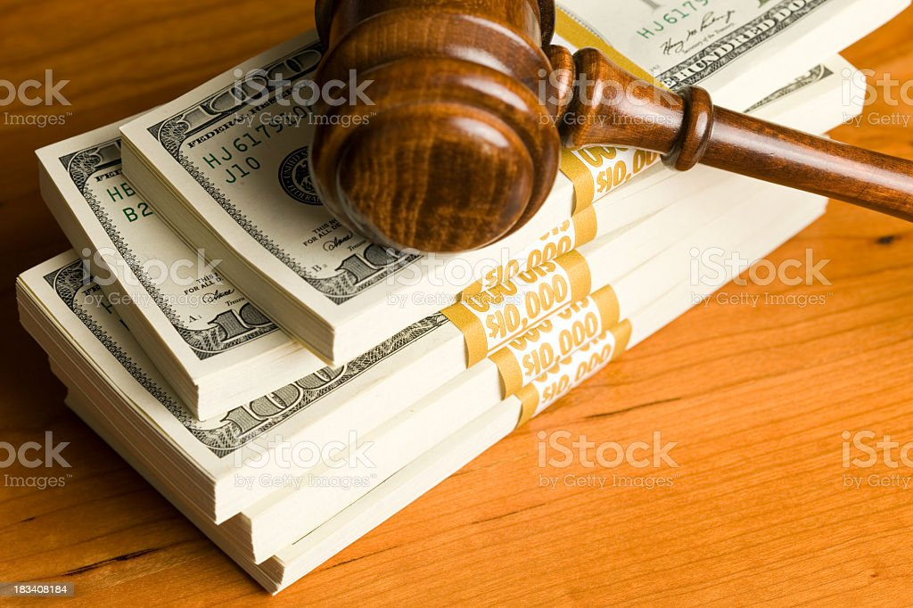 $50,000 in $100 Bills on Cherry Desk with Gavel royalty-free stock photo