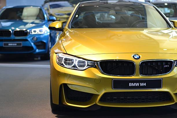 BMW M4 in a car showroom stock photo