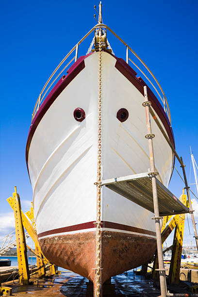 in a dry dock - yacht front view stock photos and pictures