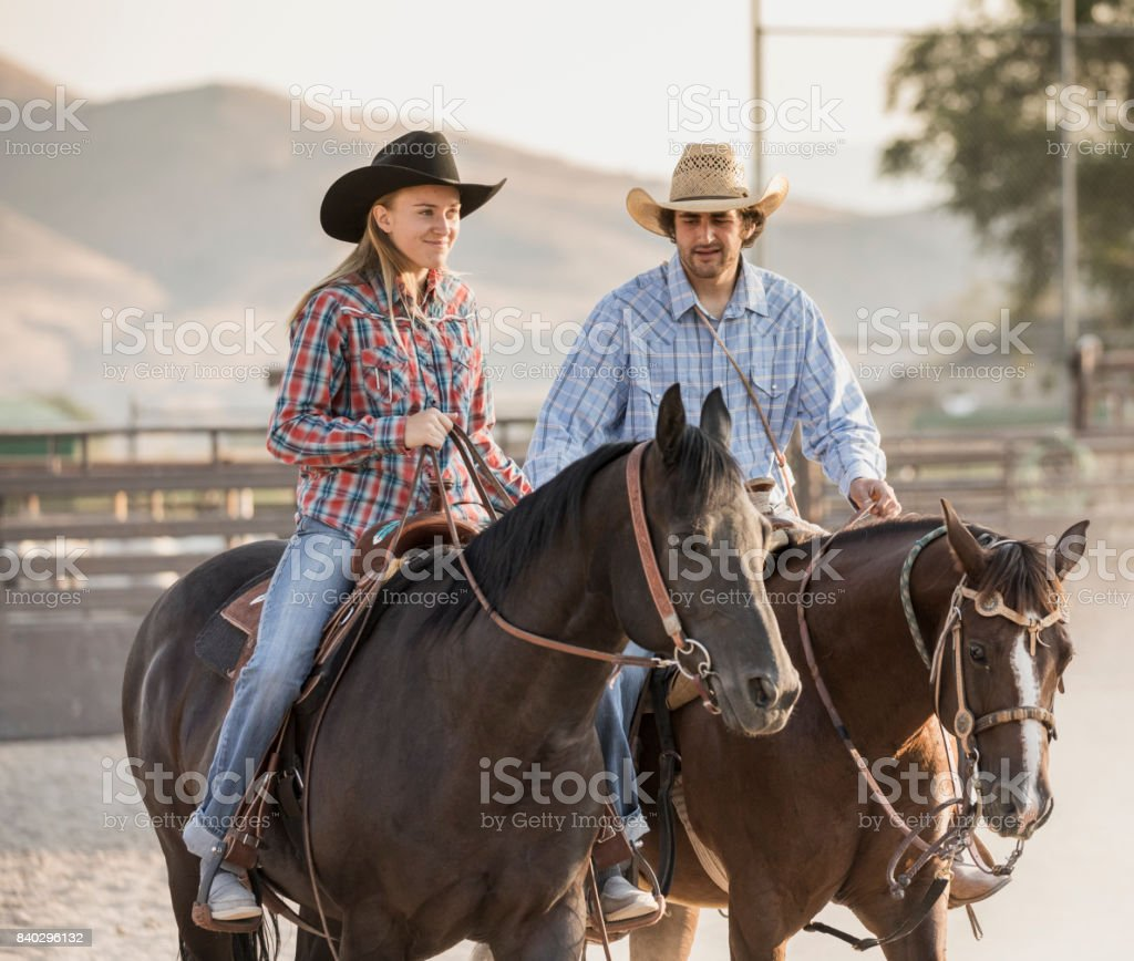 In A Rodeo Arena A Young Couple Riding Their Horses Before The Action Begins Stock Photo Download Image Now Istock