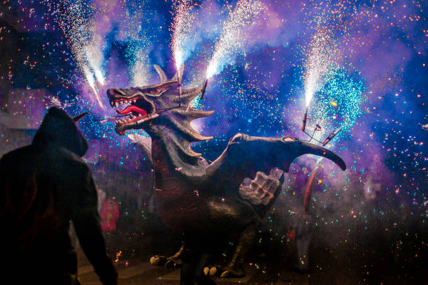 In a small Catalan village, traditional festival, called Correfoc which means running fire, being held where people form a parade, disguised as devils and other creatures while fireworks light up the street. Catalonia culture and tradition photography. pyrotechnic effects stock pictures, royalty-free photos & images