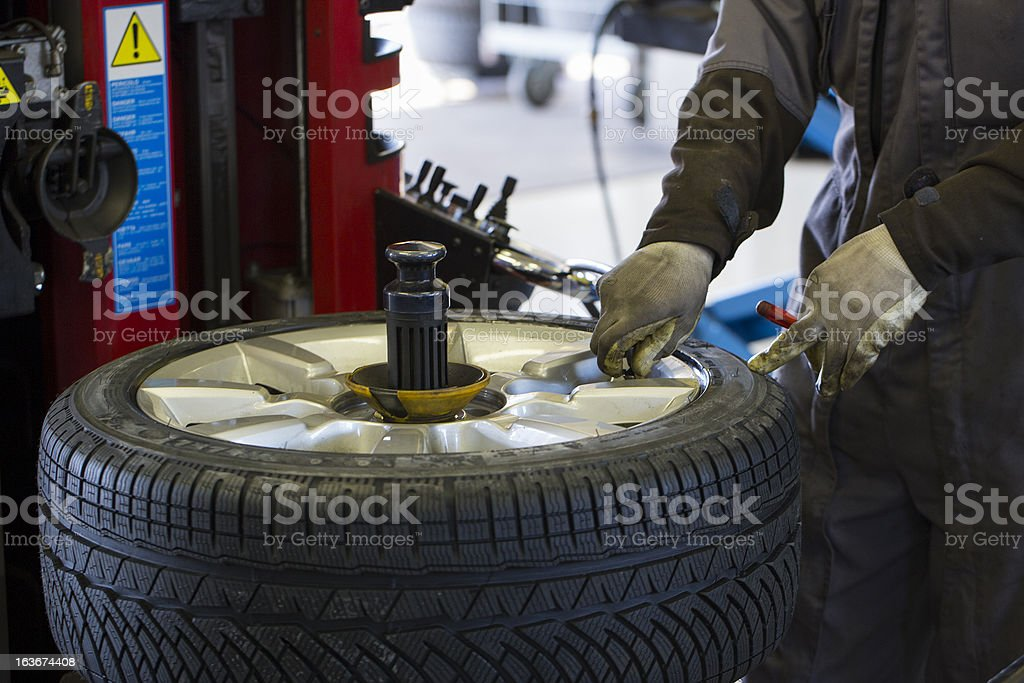 In auto repair shop....Tire air pressure test...changing tire royalty-free stock photo