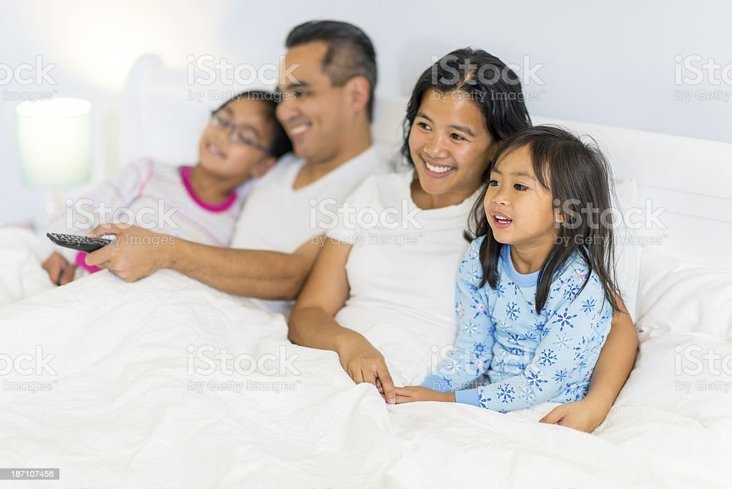 TV in bed stock photo