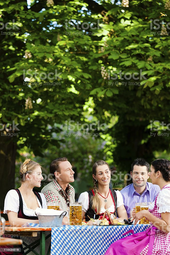 In Beer garden - friends on a table with drinks stock photo