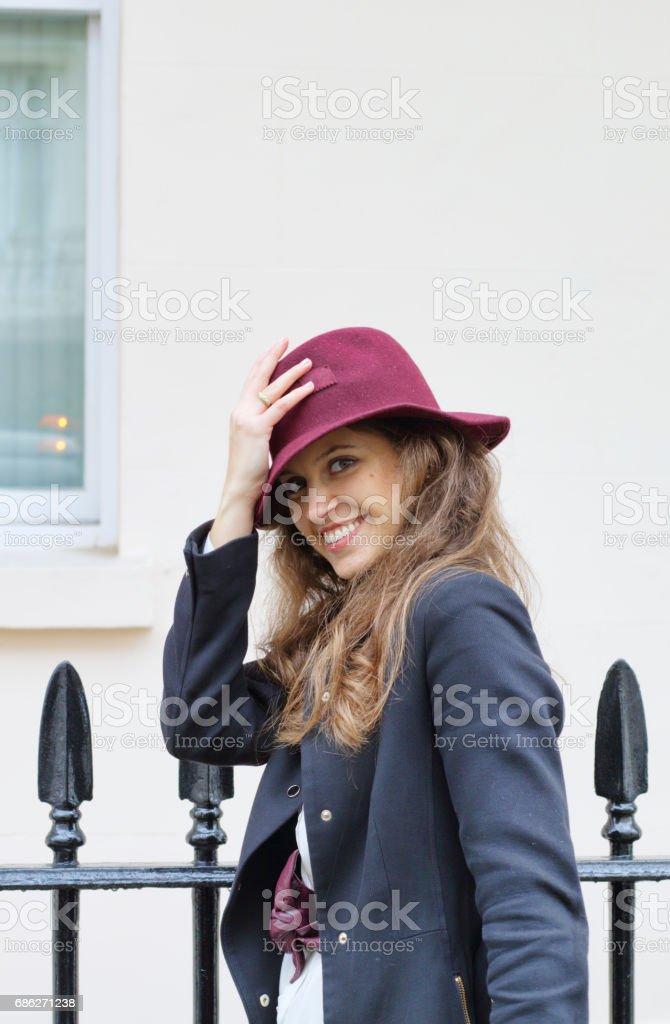 In Belgravia Russian outdoor girl fashion maroon felt hat stock photo