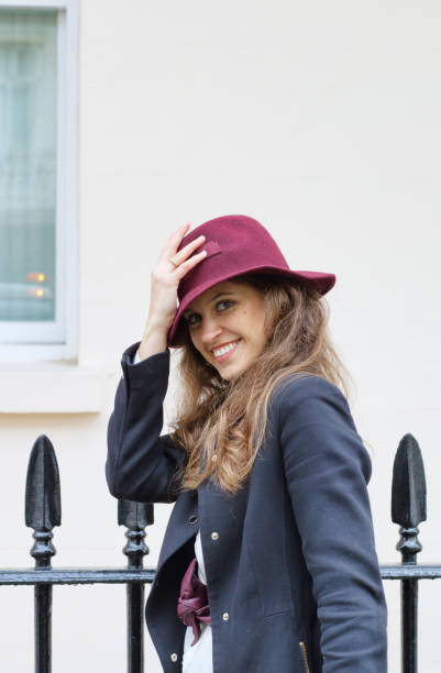 in belgravia russian outdoor girl fashion maroon felt hat - whiteway english outdoor girl stock photos and pictures