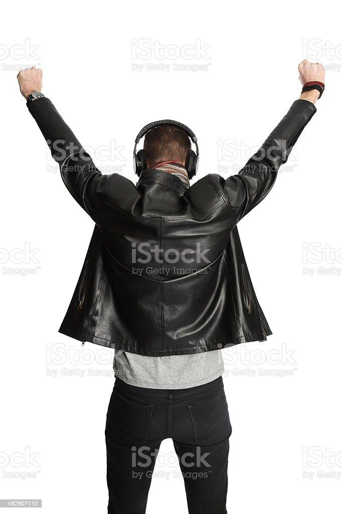 DJ in black leather jacket gesturing stock photo