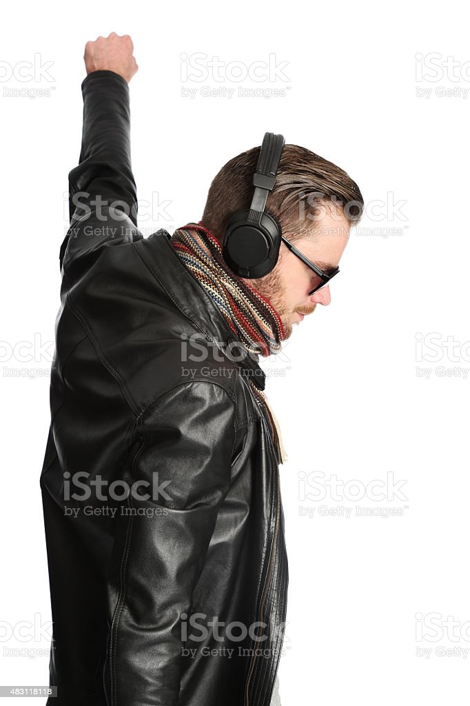 DJ in black leather jacket with raised fist stock photo