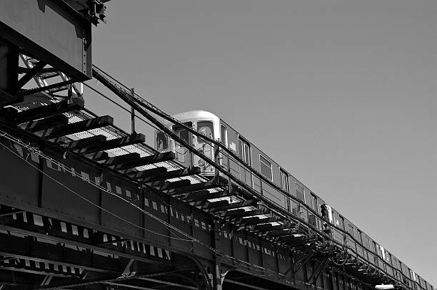 NYC in Black & White Subway train on elevated tracks stock photo