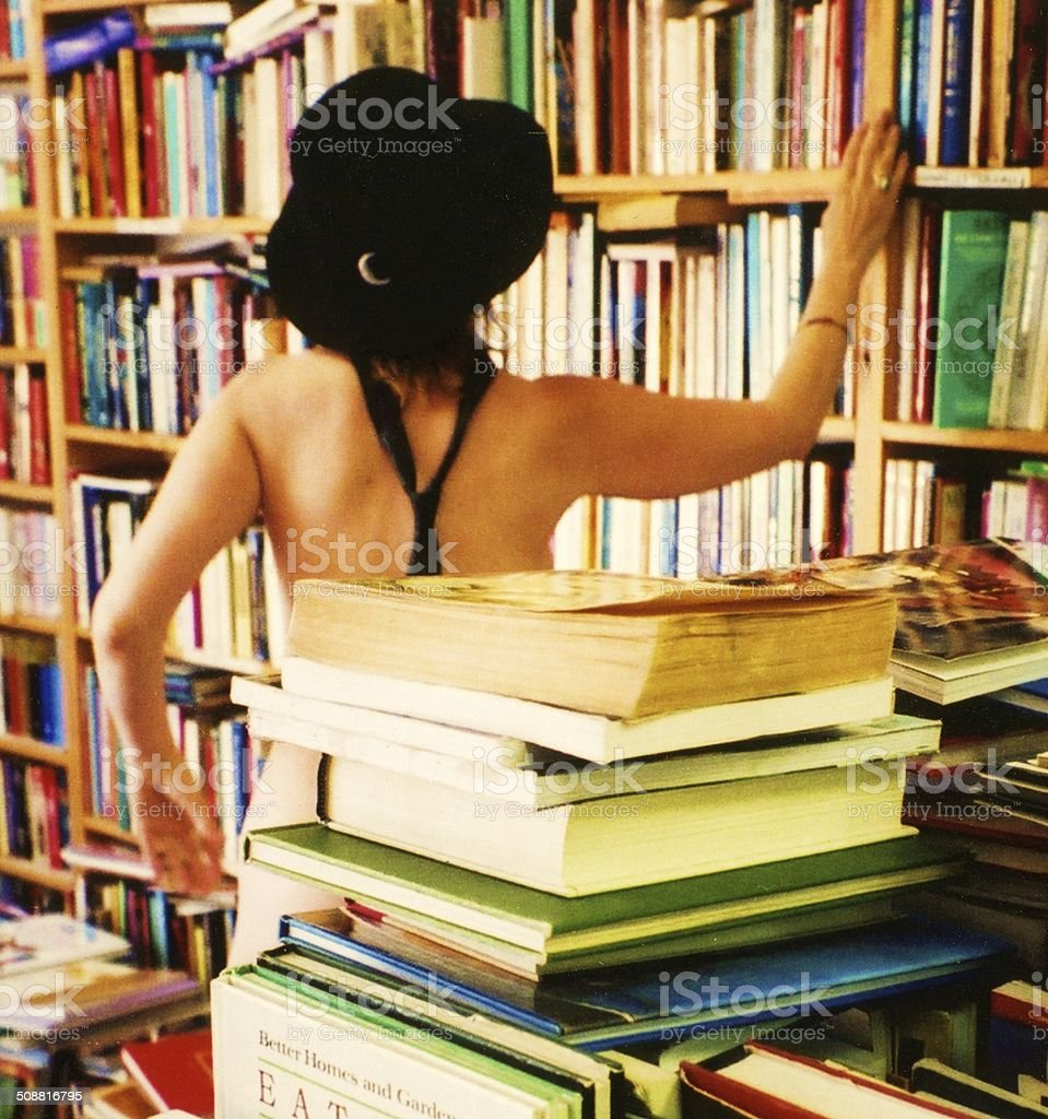 R & D in bookshop with woman stock photo