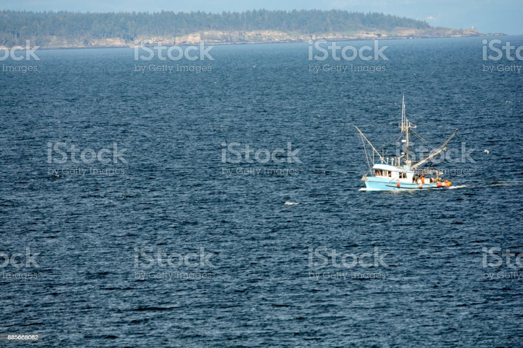 In British Columbia a commericial fishing boat trooling stock photo