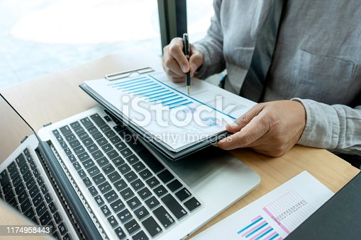 687687166 istock photo In business office businessman in meeting analyses chart 1174958443