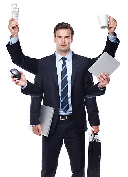 In business you need to be prepared for anything Conceptual image of a modern corporate executive and the many tasks he performs daily multi tasking stock pictures, royalty-free photos & images